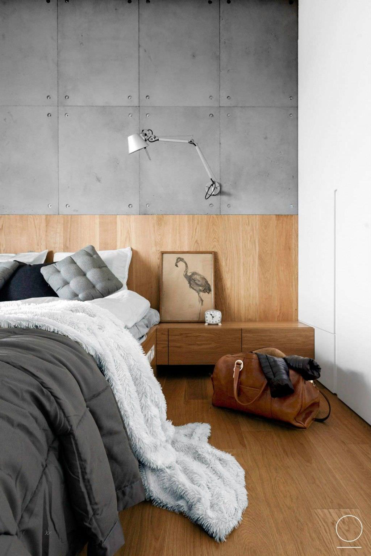 da176572af Camera da letto moderna con uno stile che varia tra il minimal della parete  in cemento